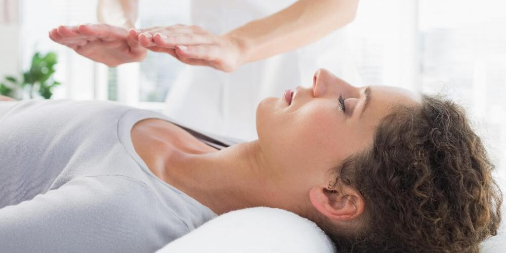 woman-getting-reiki
